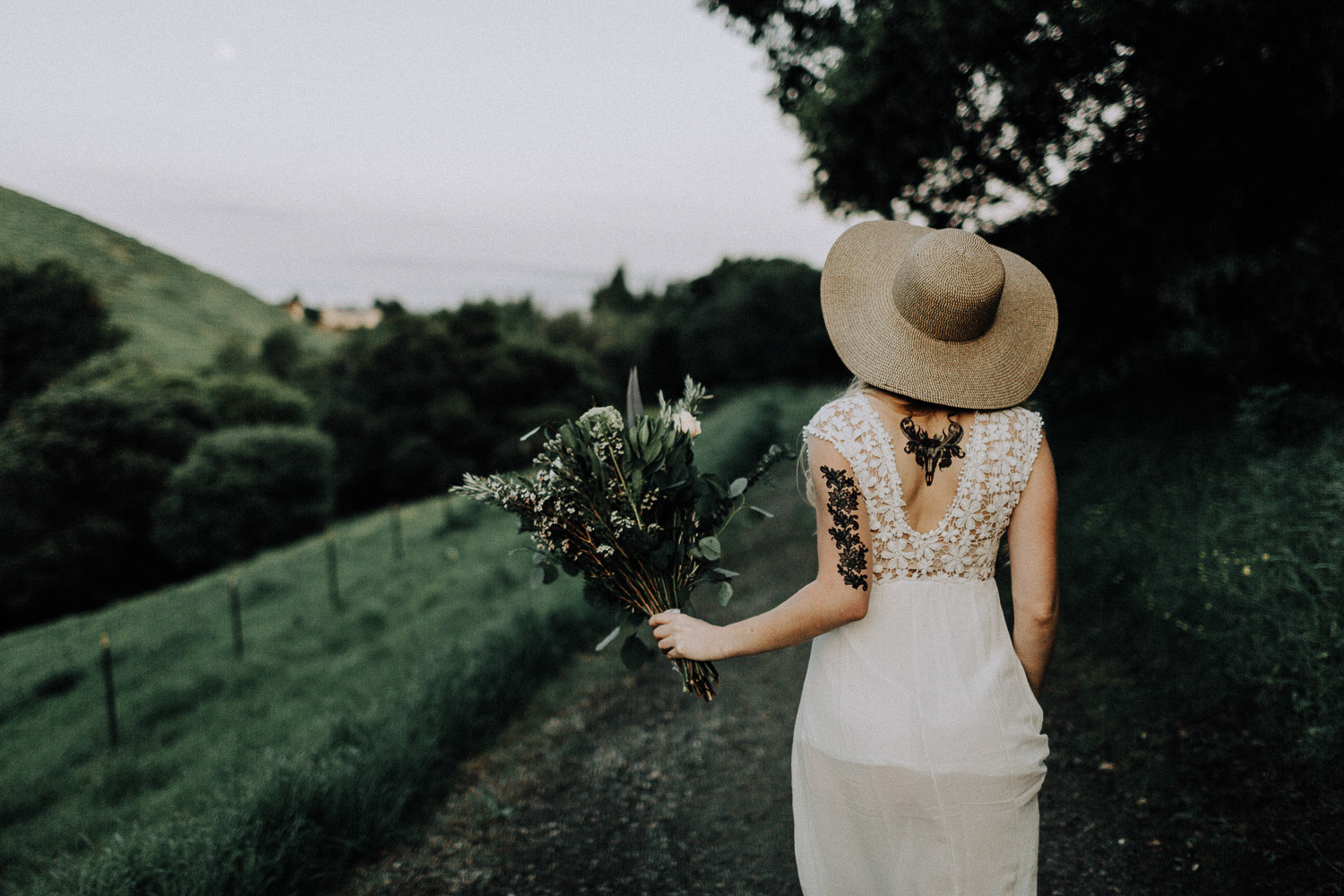 Image of bride holds the bouquet and walks forward
