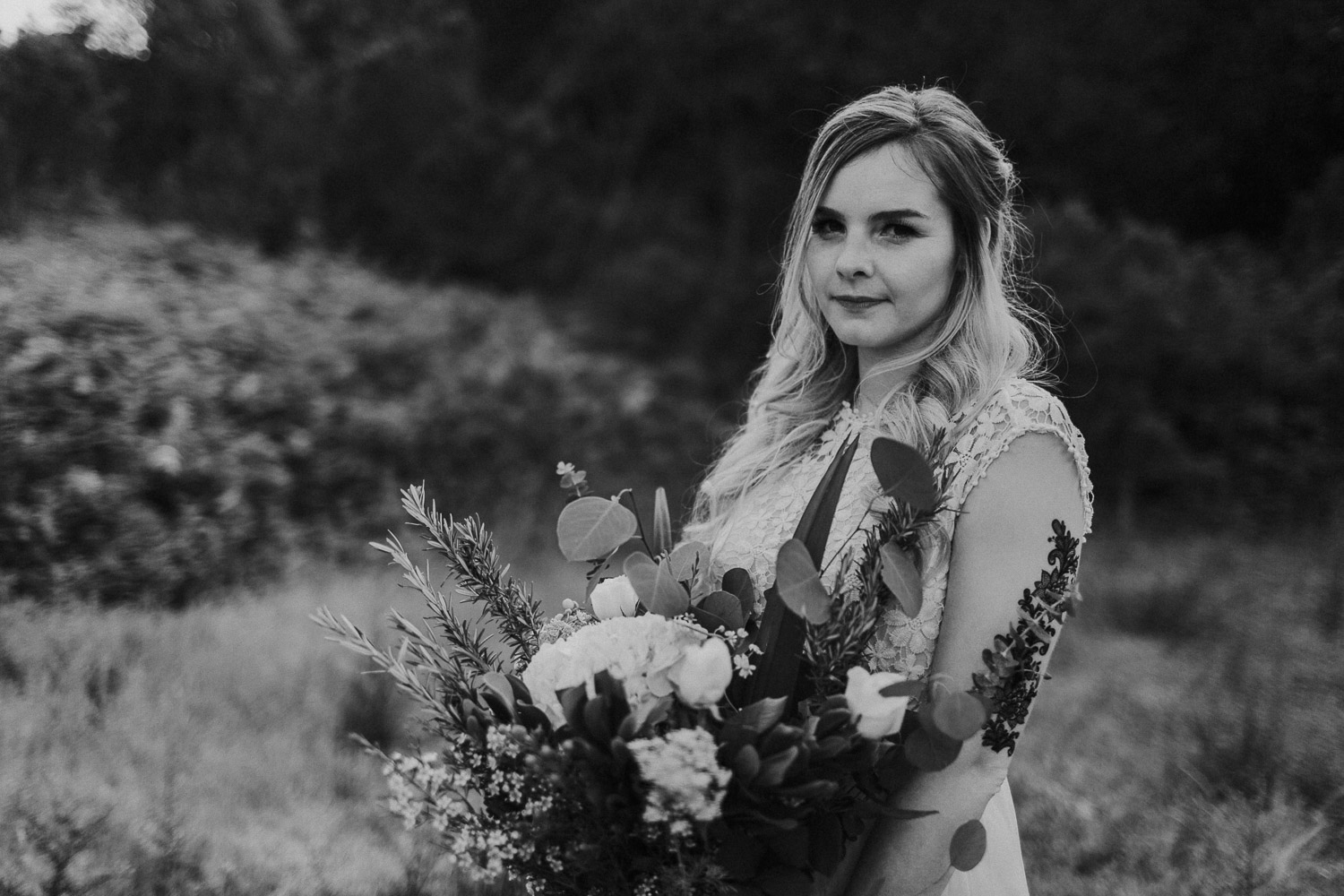 Black and White image of bride smiles