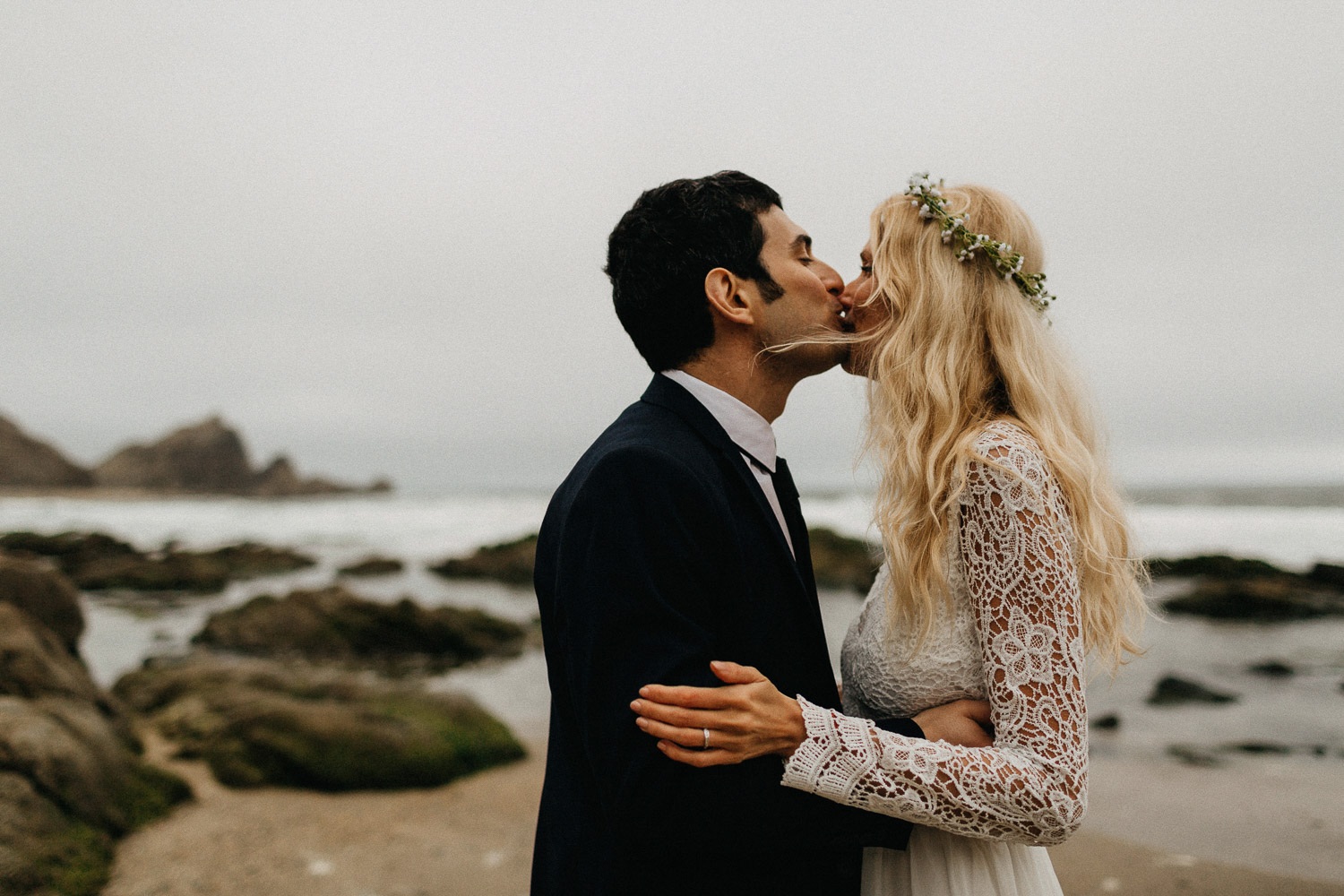 Image of groom kisses bride on lips