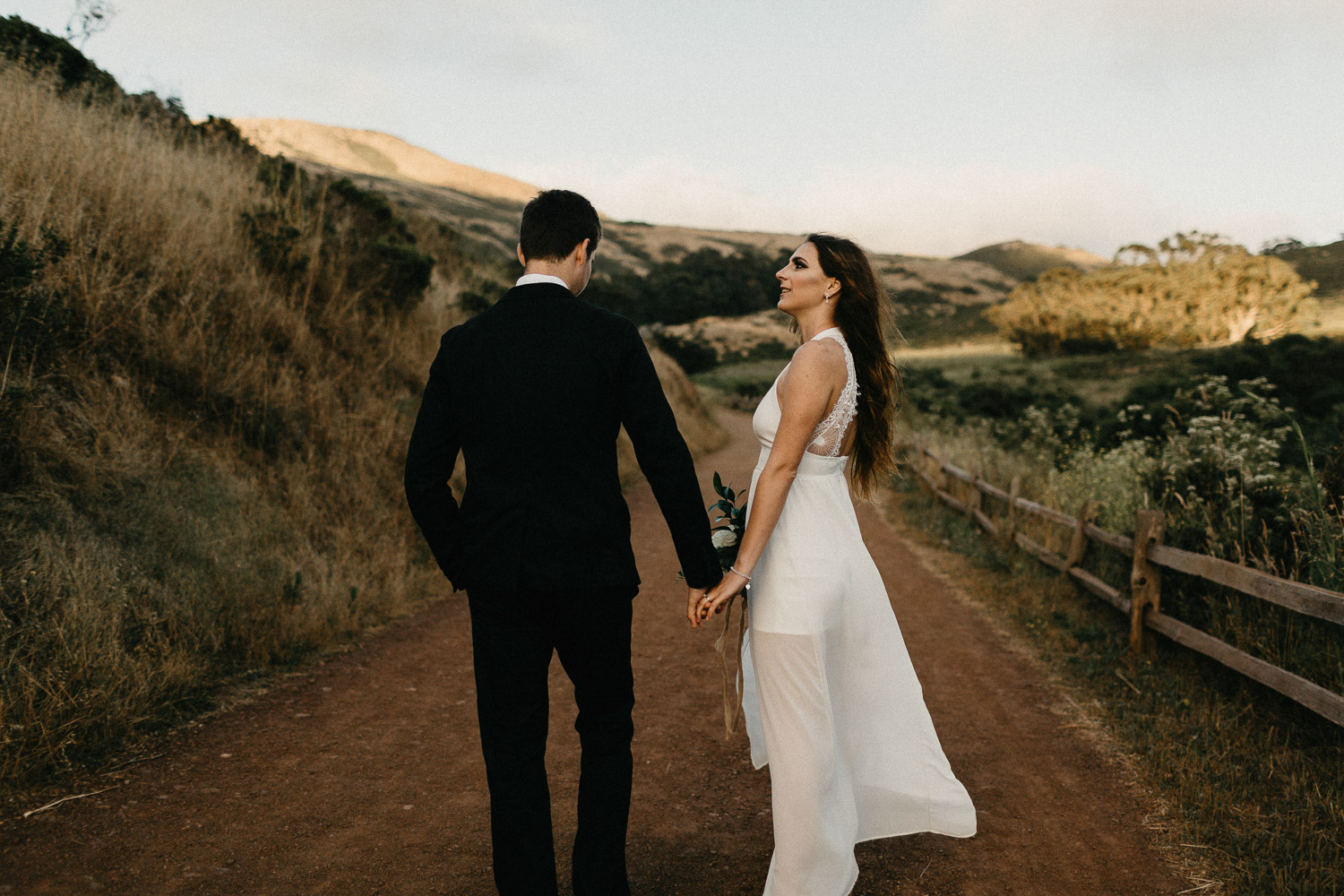 Image of groom and bride stand together on the road