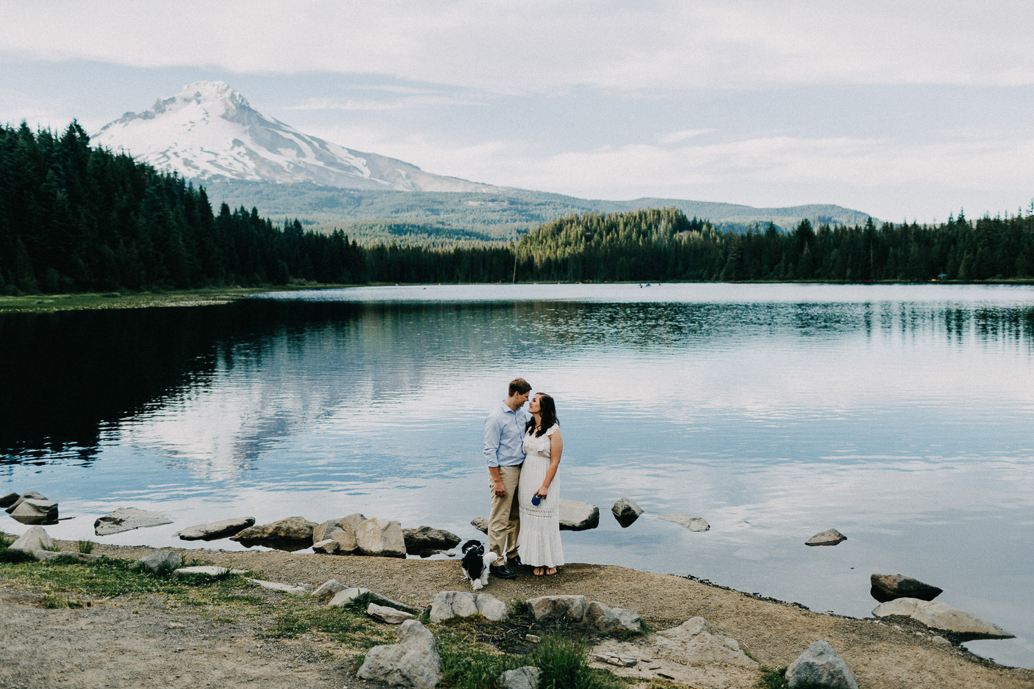 Image of couple looks at each other in front of Mt Hood