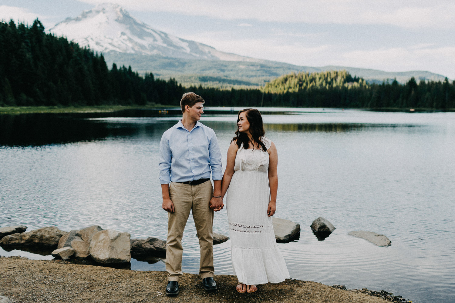 Image of couple look at each other in front of Mt Hood