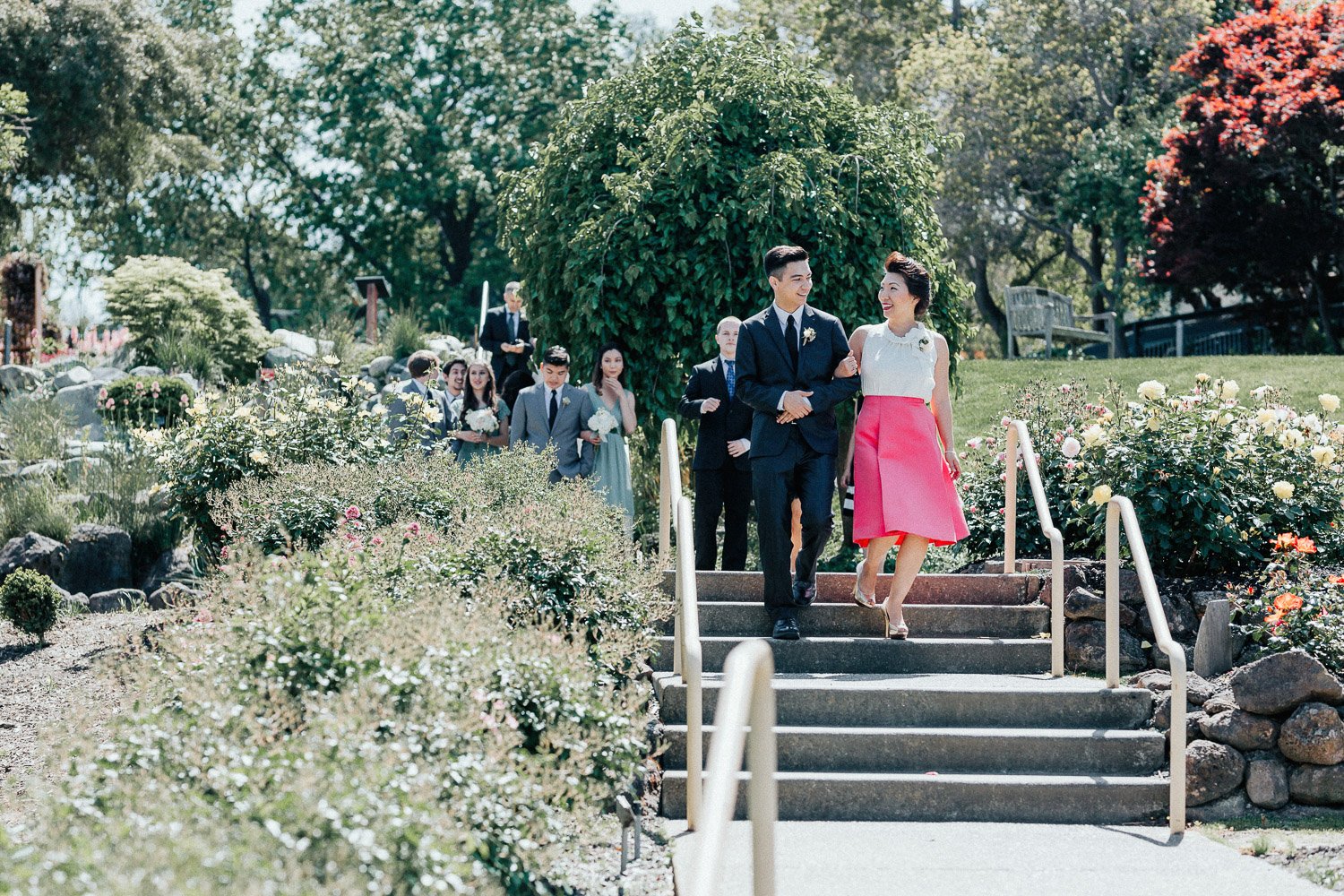 Image of groom and groom's mom walk down the aisle together