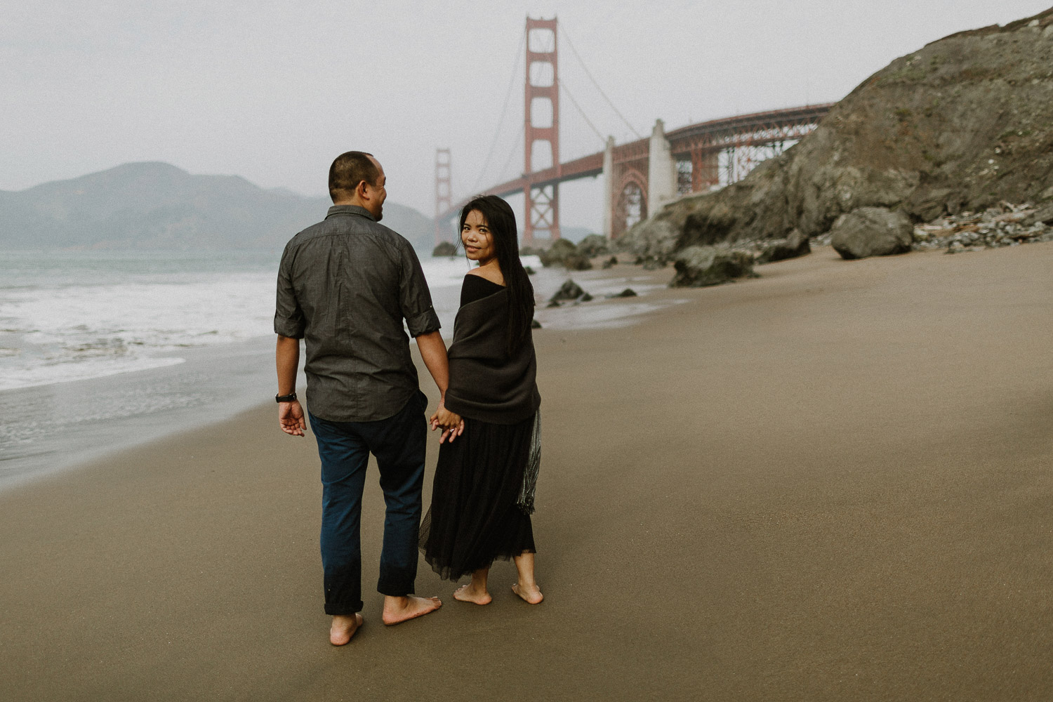 Image of Asian couple hold hands together on beach