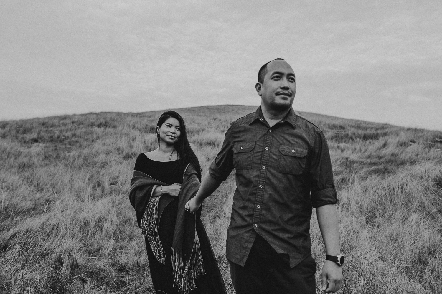 Image of Asian Couple Walks Together on the Hill