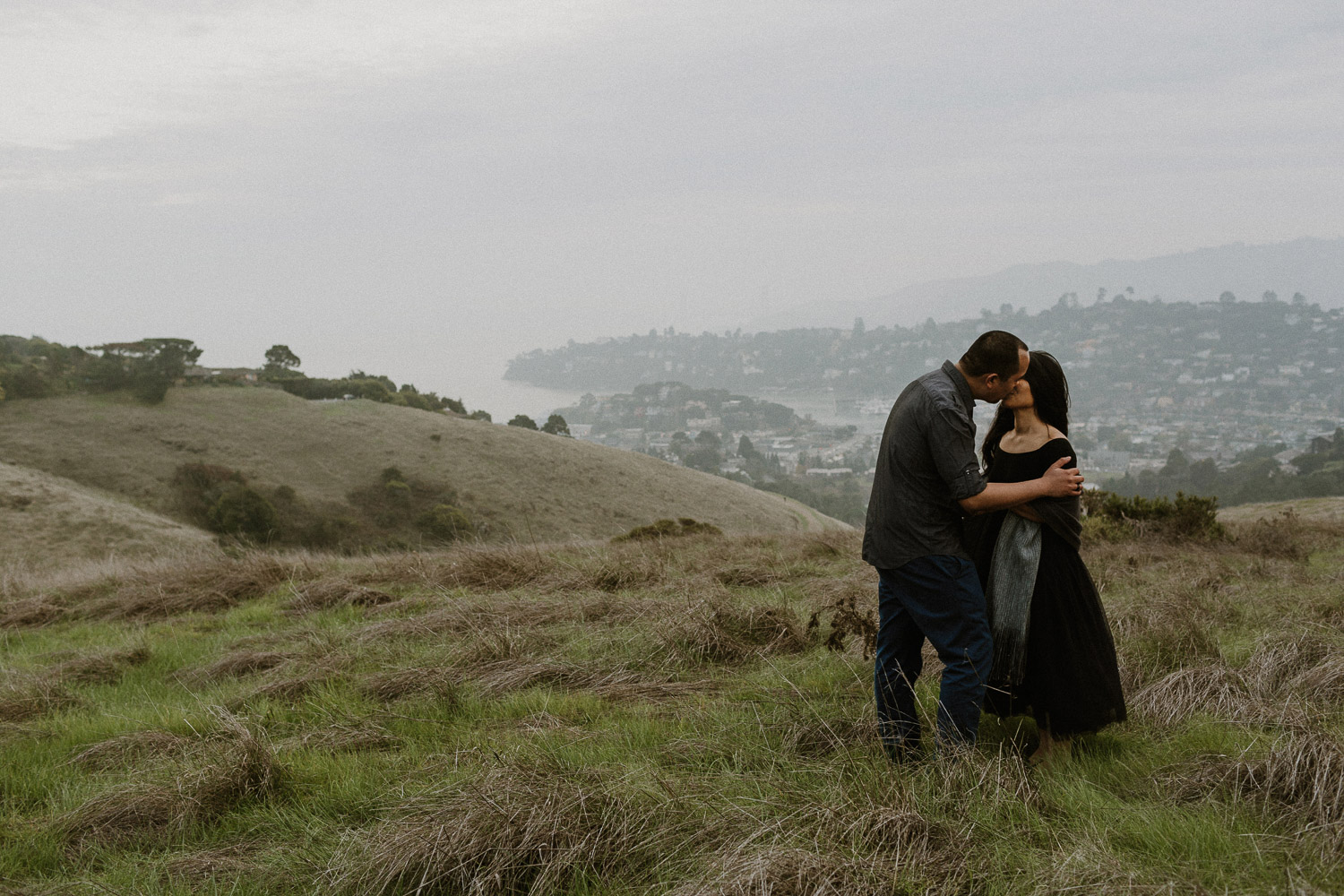 Image of Asian Couple Kisses Each Other on the Hill